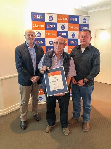 Deptyu Commisioner Greg Newton with Graeme Geyer recipient of Life Member Award together with Western Zone Commander, David Monk